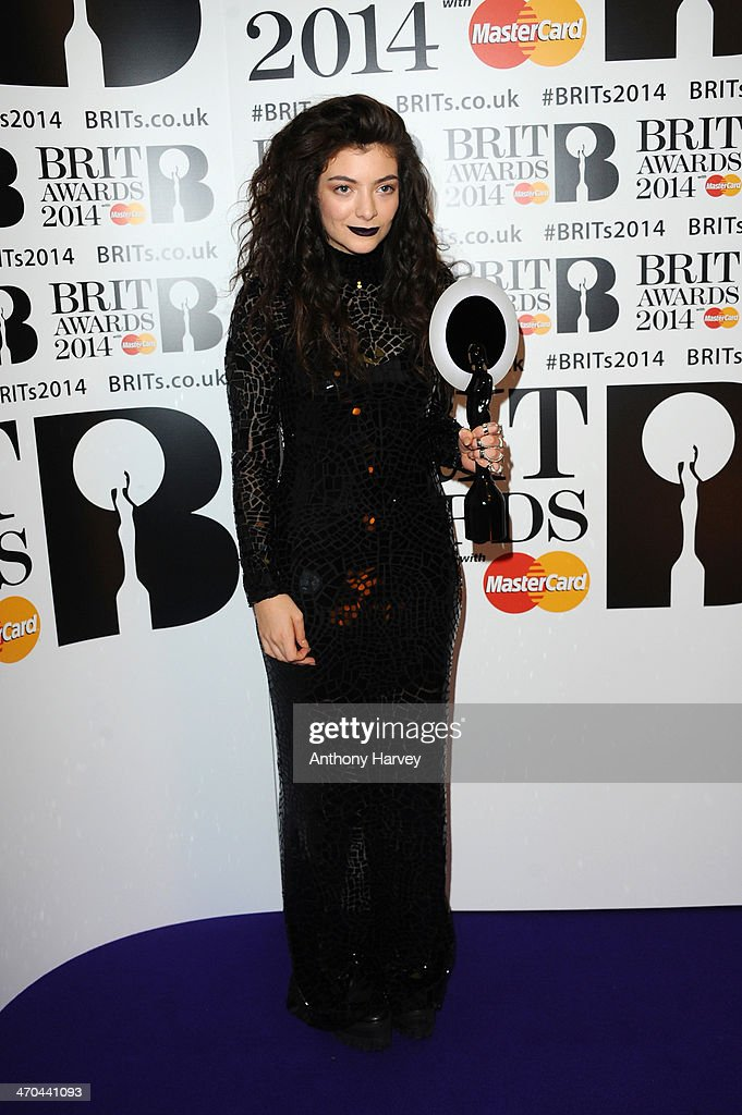 <a gi-track='captionPersonalityLinkClicked' href=/galleries/search?phrase=Lorde&family=editorial&specificpeople=3209104 ng-click='$event.stopPropagation()'>Lorde</a>, winner of the International Female Solo Artist award, poses in the winners room at The BRIT Awards 2014 at 02 Arena on February 19, 2014 in London, England.