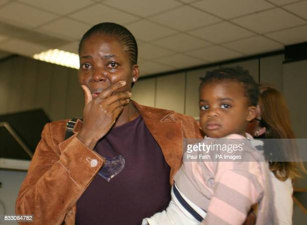 Lordorice Djountso and her daughter Imelda arrive back at Belfast International Airport after spending two months in an English detention centre