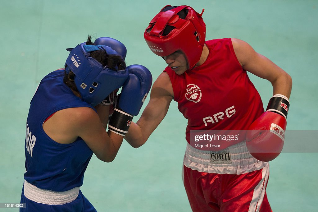 Loreley Espinosa (R) of Argentina competes with Jessica Centeno (L) of Ecuador during the women's 48-51 kg Boxing Finals as part of the I ODESUR South American Youth Games at Coliseo Miguel Grau on September 25, 2013 in Lima, Peru.