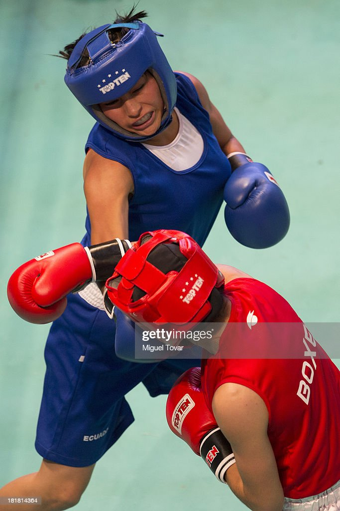 Loreley Espinosa (red) of Argentina competes with Jessica Centeno (blue) of Ecuador during the women's 48-51 kg Boxing Finals as part of the I ODESUR South American Youth Games at Coliseo Miguel Grau on September 25, 2013 in Lima, Peru.