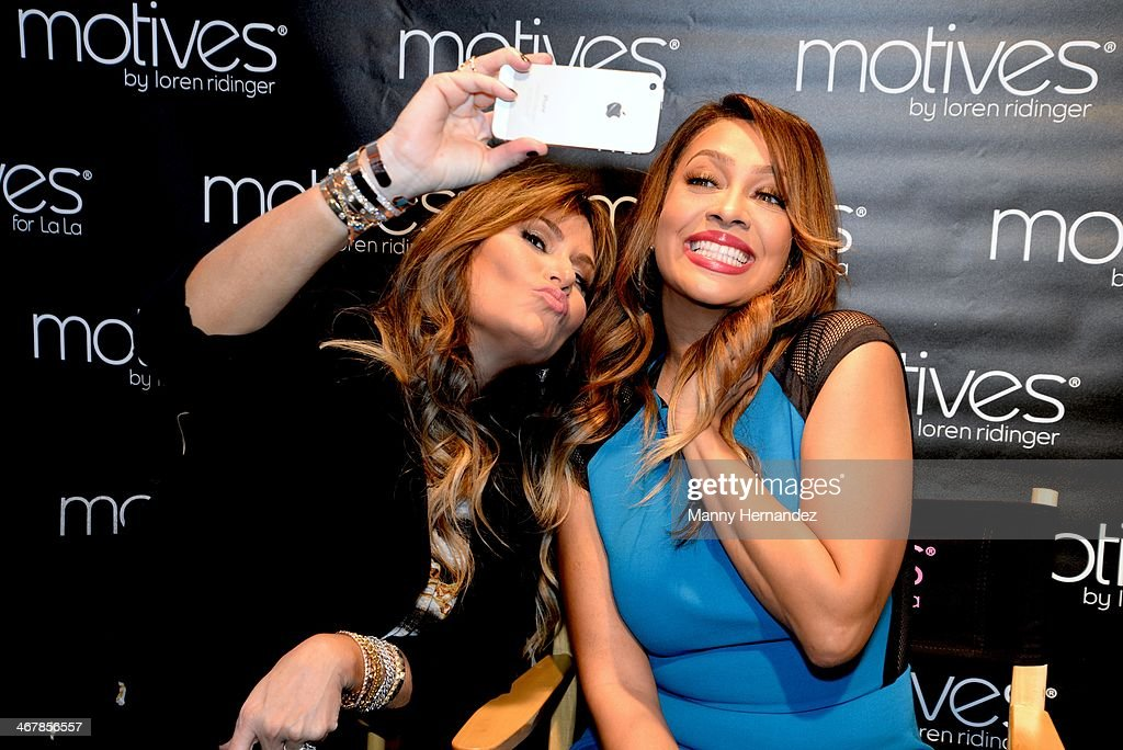 Loren Ridinger and La La Anthony at the 2014 Market America World Conference at American Airlines Arena on February 8, 2014 in Miami, Florida.