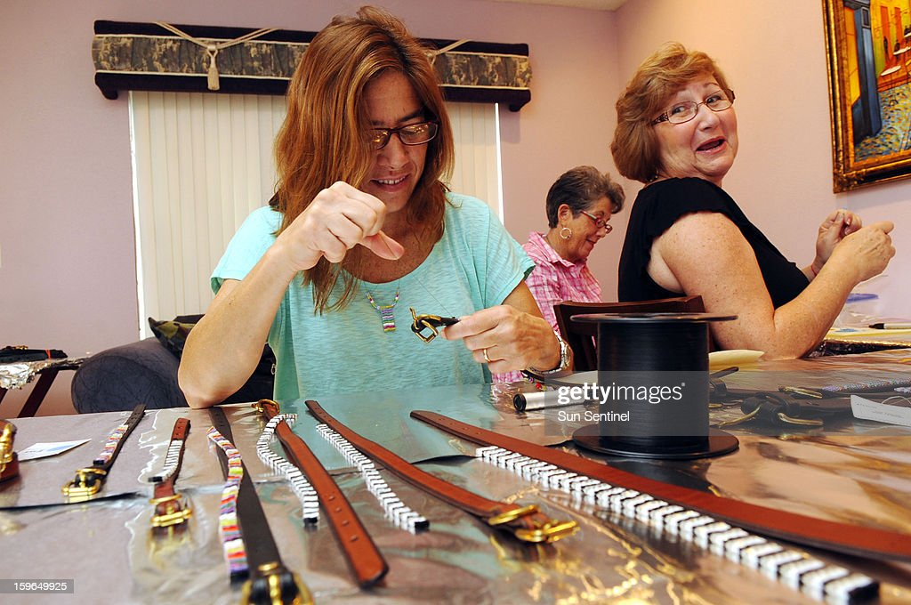 Lorena Behar, left, Sarah Clyman, right, and Cynthia Heyman, rear, share a laugh while stringing and sewing beads for hand-made pet fashion accessories by Mona Straub, founder of Just Fur Fun pet accessories in Boca Raton, Florida.