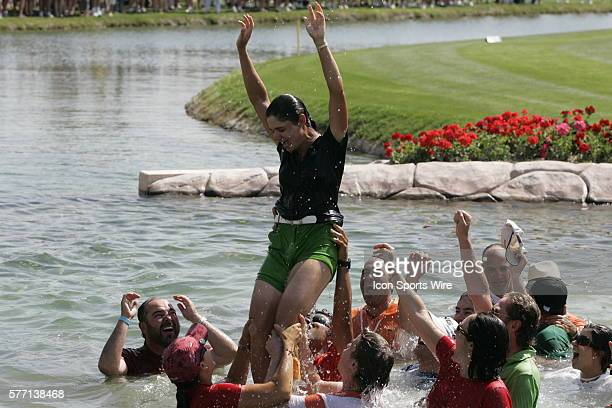 Lorena Ochoa of Mexico celebrates her victory with friends and family after jumping into the pond alongside 18th green after winning the LPGA Kraft...