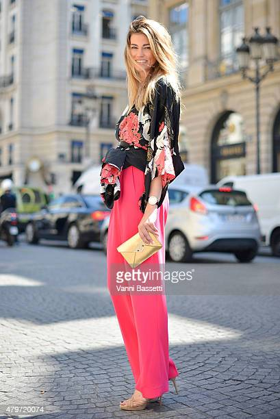 Lorena Vergani poses wearing a vintage top Sandra Mansour pants and Corto Moltedo clutch after the Schiapparelli show at Place Vendome on July 6 2015...