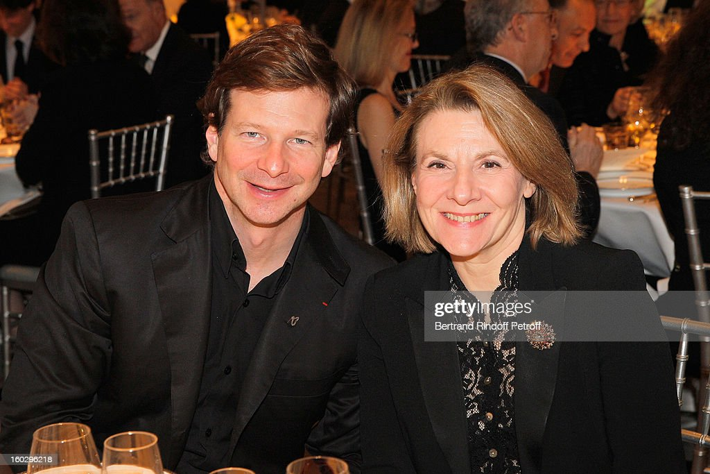 Lorenz Baumer (L) and Catherine Pegard attend a dinner in honor of Helene David-Weill at Sotheby's on January 28, 2013 in Paris, France.