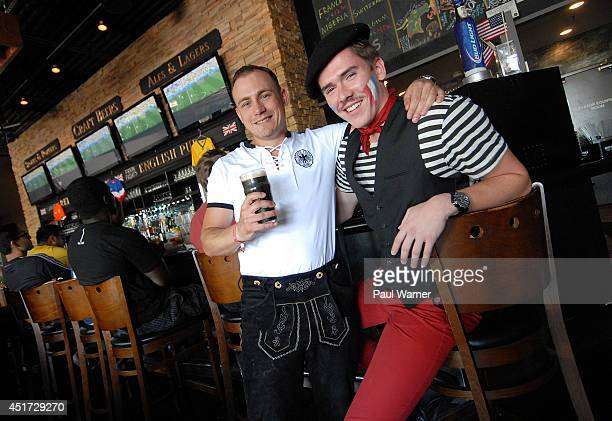 Lorenz Gradischnig from Munich Germany and Richard Dubos from Orleans France arrive at the Red Fox English Pub during the Germany vs France World Cup...