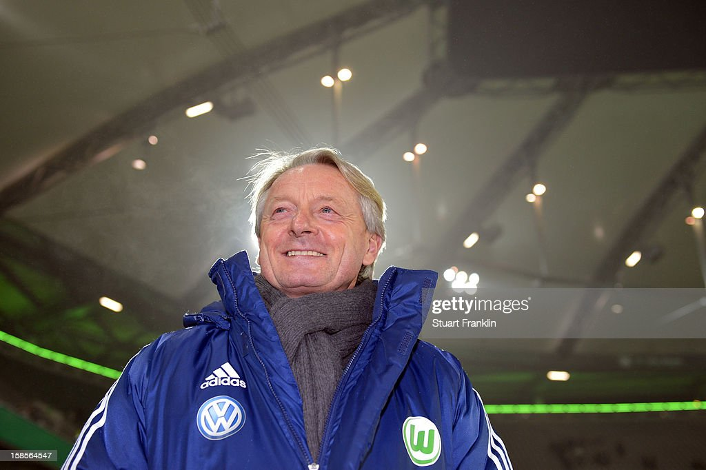 Lorenz - Guenther Koestner, head coach of Wolfsburg ponders during the round of 16 of the DFB cup match between VfL Wolfsburg and Bayer Leverkusen at Volkswagen Arena on December 19, 2012 in Wolfsburg, Germany.