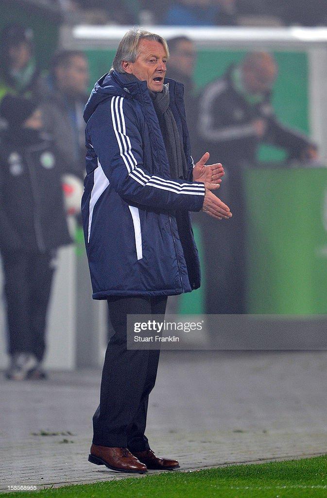 Lorenz - Guenther Koestner, head coach of Wolfsburg ponders during the round of 16 of the DFB cup match between VfL Wolfsburg and Bayer Leverkusen at Volkswagen Arena on December 19, 2012 in Wolfsburg, Germany.