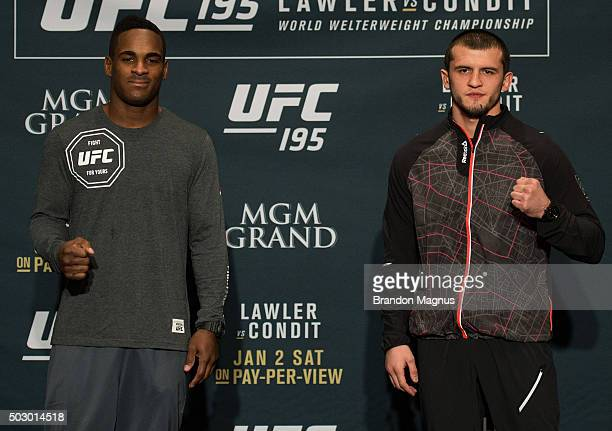 Lorenz Larkin and Albert Tumenov pose for a picture after facing off during the Ultimate Media Day at the MGM Grand Hotel/Casino on December 31 2015...