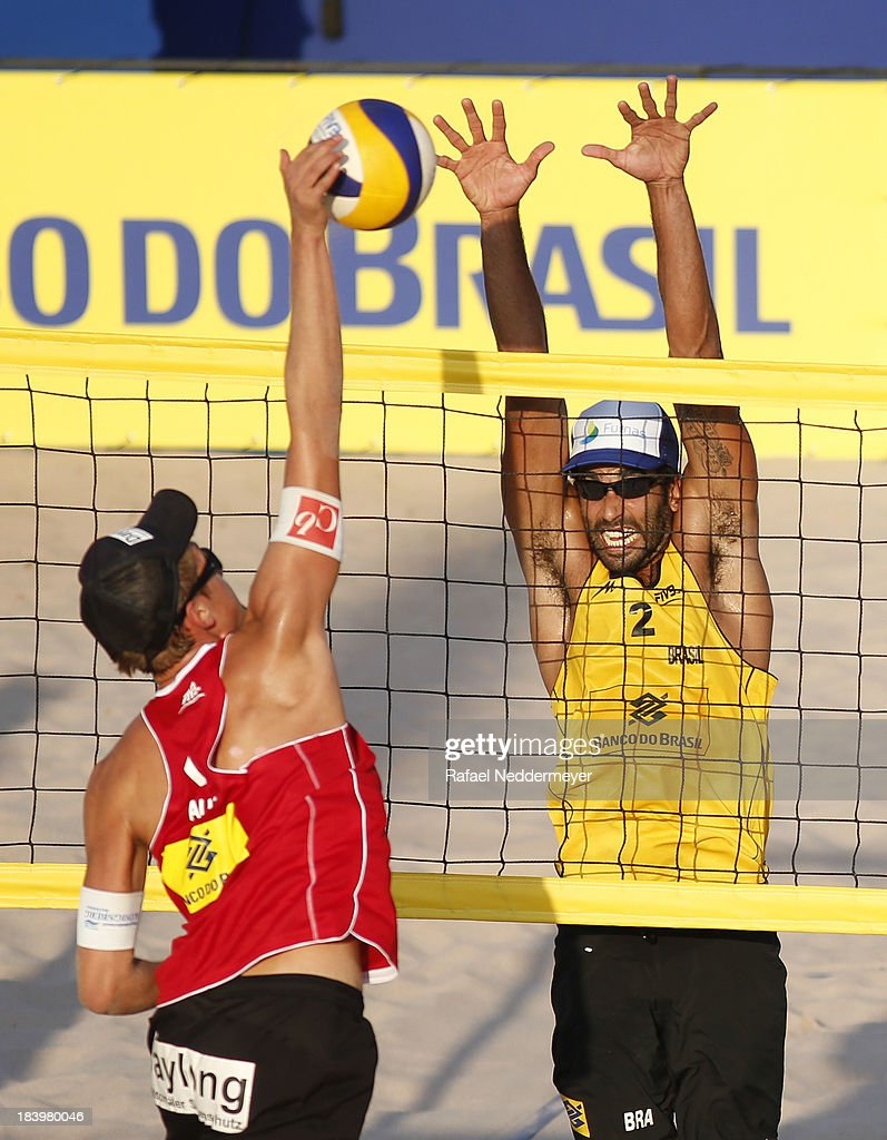 Lorenz Petutschnig of Austria and Pedro Salgado of Brazil (R) in action during day third of the FIVB Beach Volleyball Sao Paulo Grand Slam 2013 at Parque Villa Lobos on October 10, 2013 in Sao Paulo, Brazil.
