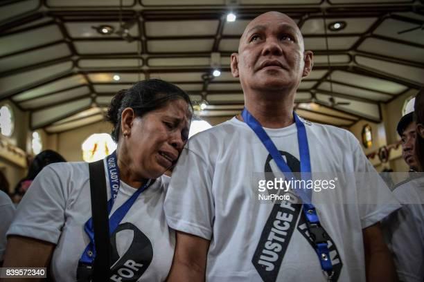 Lorenza and Saldy Delos Santos weep during the funeral rites of their son Kian Loyd Delos Santos in Caloocan Metro Manila Philippines August 26 2017...