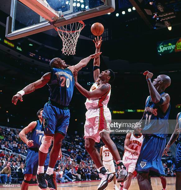 Lorenzen Wright of the Atlanta Hawks shoots against the Minnesota Timberwolves on December 14 1999 at Philips Arena in Atlanta Georgia NOTE TO USER...