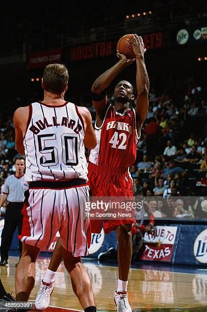 Lorenzen Wright of the Atlanta Hawks shoots over Matt Bullard of the Houston Rockets during the game on April 7 2001 at Compaq Center in Houston...