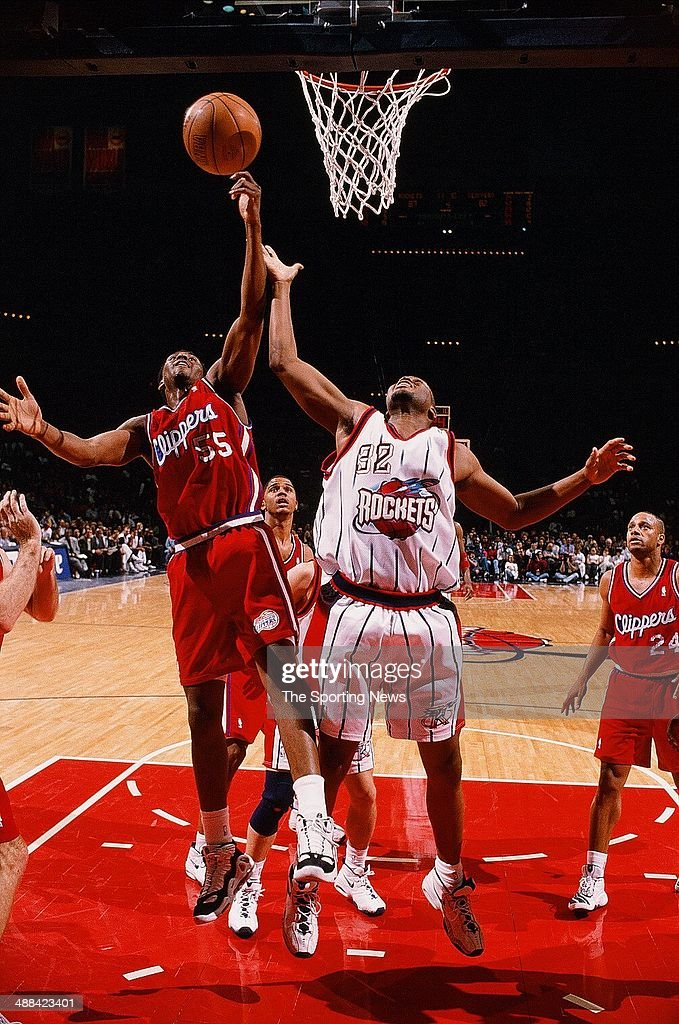 Lorenzen Wright #55 of the Los Angeles Clippers and Othella Harrington #32 of the Houston Rockets go for a rebound during the game on January 27, 1998 at Compaq Center in Houston, Texas. The Rockets won 115-109.