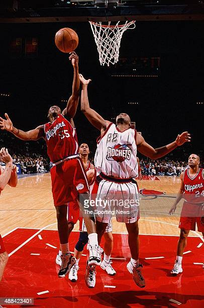 Lorenzen Wright of the Los Angeles Clippers and Othella Harrington of the Houston Rockets go for a rebound during the game on January 27 1998 at...