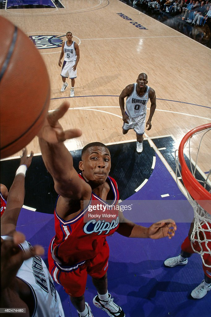 Lorenzen Wright of the Los Angeles Clippers blocks a shot against the Sacramento Kings during a game circa 1997 at Arco Arena in Sacramento, California.