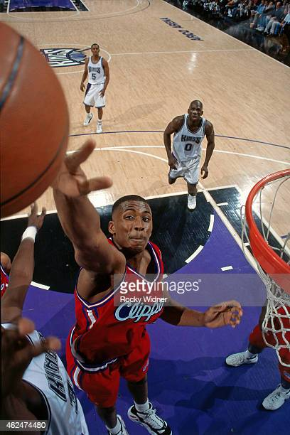 Lorenzen Wright of the Los Angeles Clippers blocks a shot against the Sacramento Kings during a game circa 1997 at Arco Arena in Sacramento...