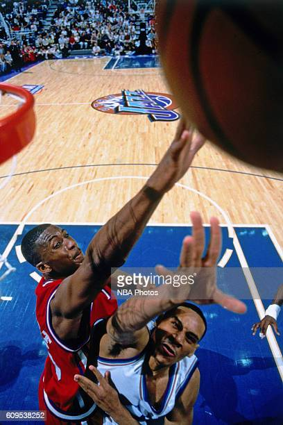 Lorenzen Wright of the Los Angeles Clippers goes to the basket against Howard Eisley of the Utah Jazz in Circa 1997 at the Delta Center in Salt Lake...