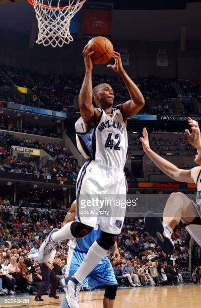 Lorenzen Wright of the Memphis Grizzlies grabs a rebound against the Denver Nuggets at FedexForum on February 25 2005 in Memphis Tennessee NOTE TO...