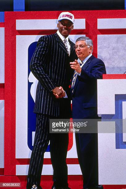 Lorenzen Wright poses with NBA Commissioner David Stern after he was drafted be the Los Angeles Clippers on June 26 1996 in East Rutherford New...