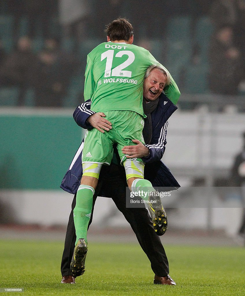 Lorenz-Guenther Koestner, head coach of Wolfsburg celebrates with <a gi-track='captionPersonalityLinkClicked' href=/galleries/search?phrase=Bas+Dost&family=editorial&specificpeople=7467816 ng-click='$event.stopPropagation()'>Bas Dost</a> (L) after winning the DFB Cup round of sixteen match between VfL Wolfsburg and Bayer Leverkusen at Volkswagen Arena on December 19, 2012 in Wolfsburg, Germany.