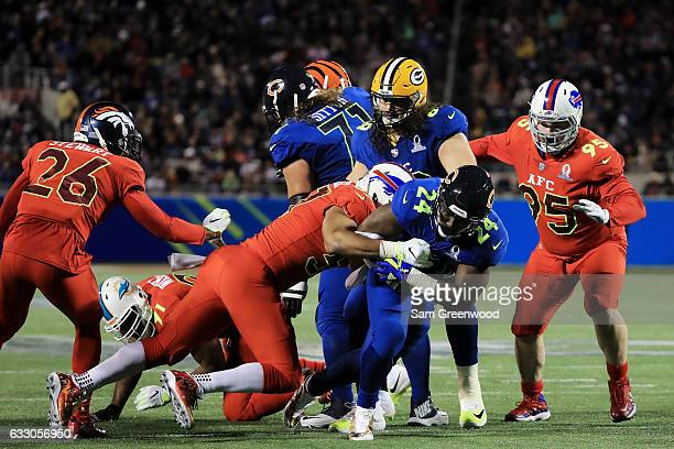 Lorenzo Alexander of the AFC tackles Jordan Howard of the NFC in the first half during the NFL Pro Bowl at the Orlando Citrus Bowl on January 29 2017...