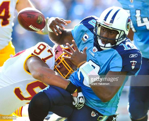 Lorenzo Alexander of the Washington Redskins forces a fumble by quarterback Vince Young of the Tennessee Titans during the first half at LP Field on...