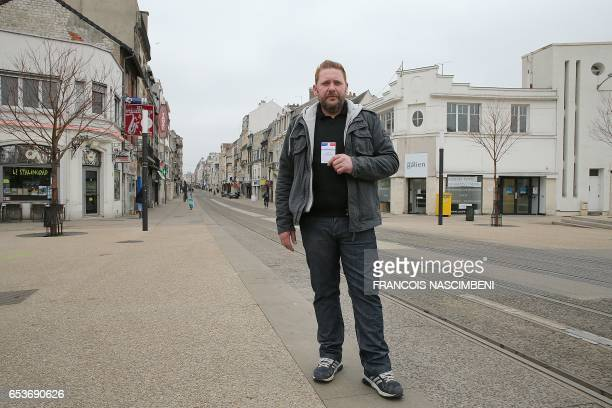 Lorenzo Amblot homeless man single living in Reims northeastern France poses with his voting card in Reims on February 20 2017 What should be the...