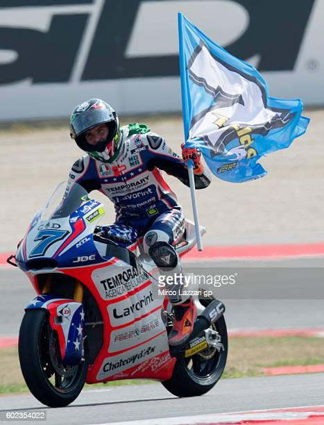 Lorenzo Baldassarri of Forward Team celebrates winning the Moto2 race at Misano World Circuit on September 11 2016 in Misano Adriatico Italy