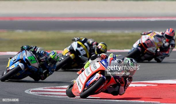 Lorenzo Baldassarri of Forward Team leads the pack during Moto2 race at Misano World Circuit on September 11 2016 in Misano Adriatico Italy