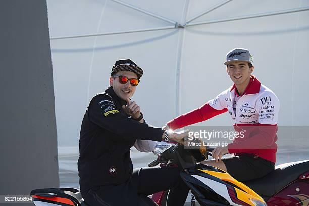 Lorenzo Baldassarri of Italy and Forward Team and Francesco Bagnaia of Italy and Aspar Team Moto3 speak in paddock during the MotoGP of Valencia...