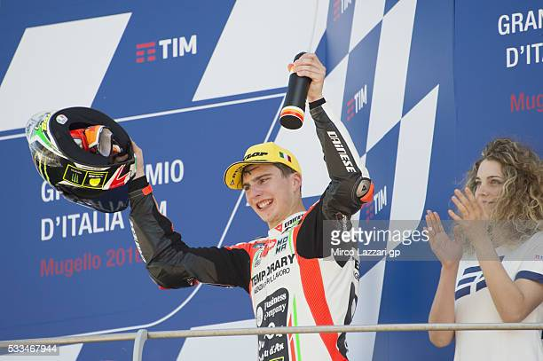 Lorenzo Baldassarri of Italy and Forward Team celebrates second place on the podium at the end of the Moto2 race during MotoGp of Italy Race at...