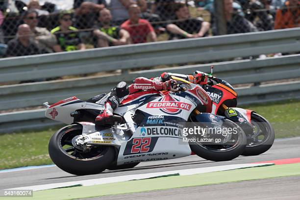 Lorenzo Baldassarri of Italy and Forward Team leads Sam Lowes of Britain and Feder Oil Gresini Moto2 during the Moto2 race during the MotoGP...