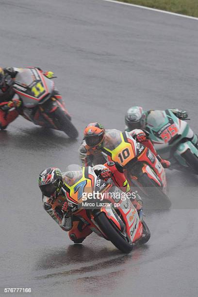 Lorenzo Baldassarri of Italy and Forward Team leads the field during the Moto2 race during the MotoGp of Germany Race at Sachsenring Circuit on July...