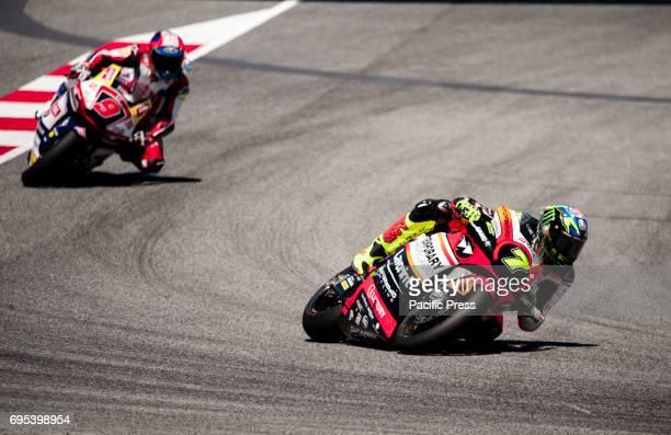 Lorenzo Baldassarri rider of Forward Racing Moto2 team in action leads Jorge Navarro of the Federal Oil Gresi in action during MotoGP at Gran Premi...