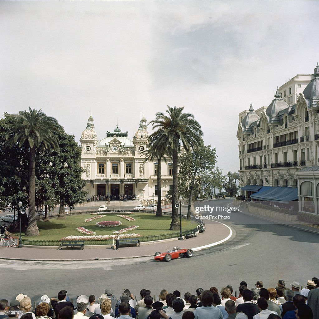 Lorenzo Bandini of Italy drives the Scuderia Ferrari Ferrari 156 sharknose through Casino Square during the Monaco Grand Prix on 3rd June 1962 on the...