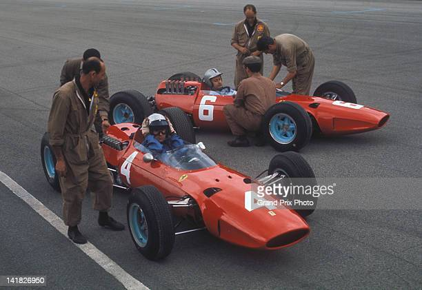 Lorenzo Bandini of Italy sits aboard the Scuderia Ferrari Ferrari 1512 Ferrari Flat12 alongside team mate and compatriot Nino Vaccarella in the...
