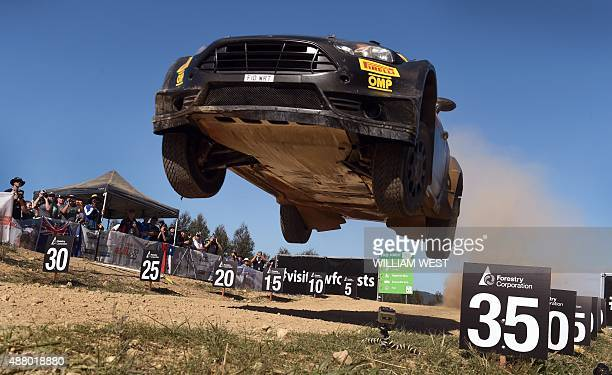Lorenzo Bertelli of Italy leaps over a brow in his Ford during the final day of the Rally of Australia World Rally Championship event in Coffs...