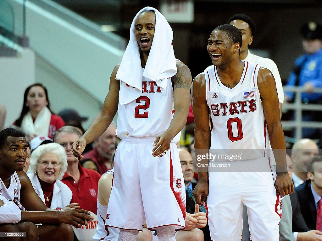 Lorenzo Brown #2 and Rodney Purvis #0 of the North Carolina State Wolfpack cheer on the reserves during the final minute of a win over the Boston College Eagles during play at PNC Arena on February 27, 2013 in Raleigh, North Carolina. North Carolina State won 82-64.