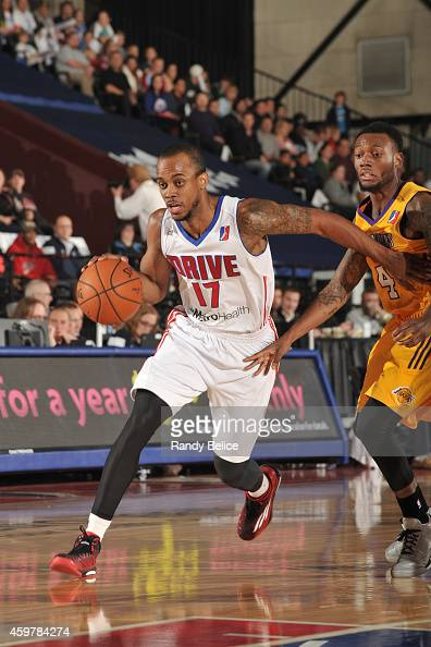 Lorenzo Brown of the Grand Rapids Drive moves the ball past Naadir Tharpe of the Los Angeles DFenders during the NBA DLeague game on November 26 2014...