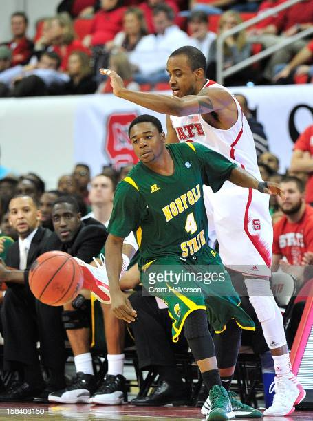 Lorenzo Brown of the North Carolina State Wolfpack and Marese Phelps of the Norfolk State Spartans chase down a loose ball during play at PNC Arena...