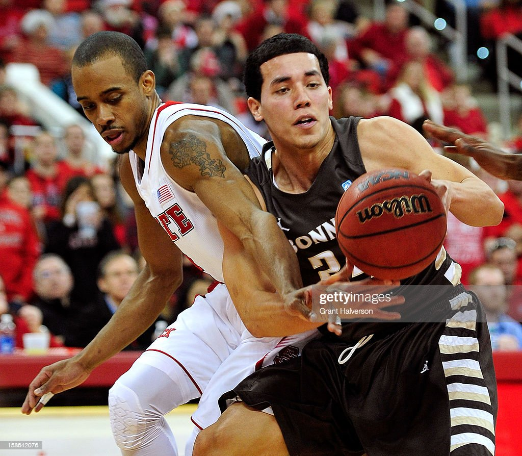 Lorenzo Brown #2 of the North Carolina State Wolfpack battles for the ball with Matthew Wright #24 of the St. Bonaventure Bonnies during play at PNC Arena on December 22, 2012 in Raleigh, North Carolina.