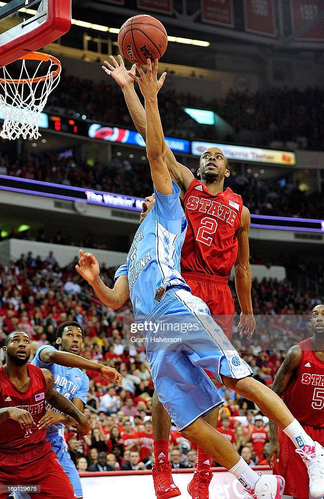 Lorenzo Brown #2 of the North Carolina State Wolfpack blocks a shot by Marcus Paige #5 of the North Carolina Tar Heels during play at PNC Arena on January 26, 2013 in Raleigh, North Carolina. North Carolina State won 91-83.