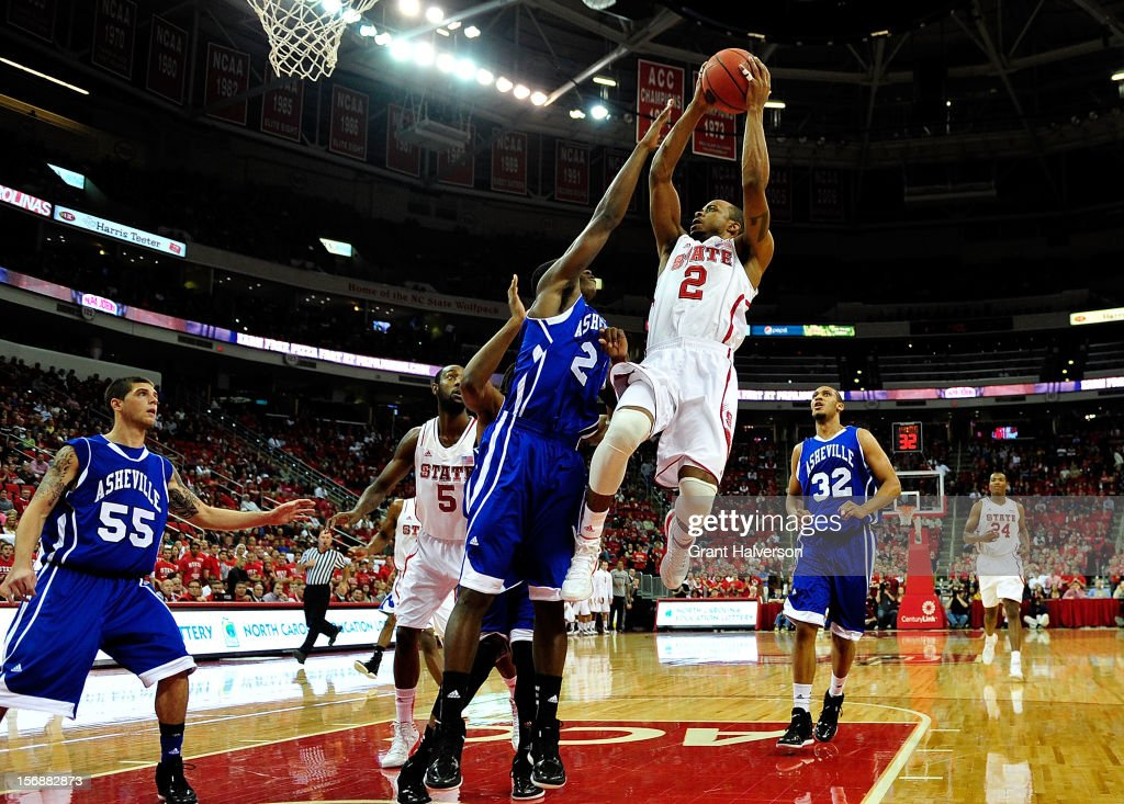 Lorenzo Brown #2 of the North Carolina State Wolfpack drives to the basket against Marcus Neely #2 of the North Carolina-Asheville Bulldogs during play at PNC Arena on November 23, 2012 in Raleigh, North Carolina.