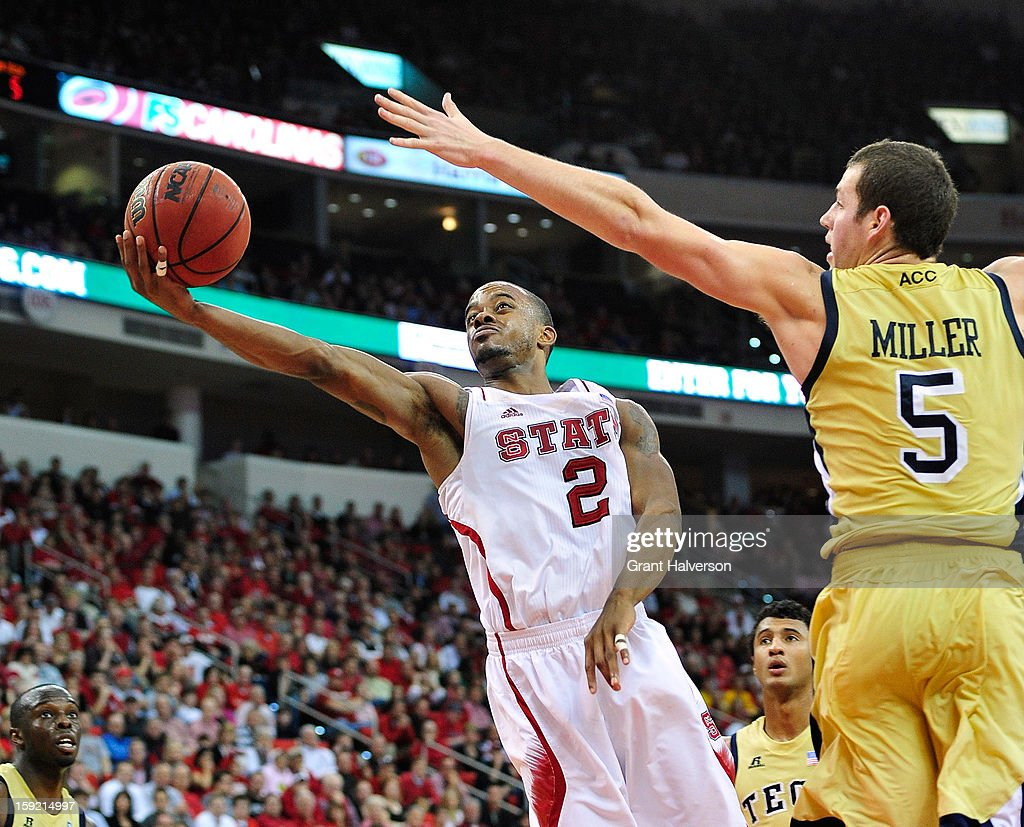 Lorenzo Brown #2 of the North Carolina State Wolfpack drives to the basket against Daniel Miller #5 of the Georgia Tech Yellow Jackets during play at PNC Arena on January 9, 2013 in Raleigh, North Carolina. North Carolina State won 83-70.