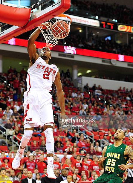 Lorenzo Brown of the North Carolina State Wolfpack dunks over Malcolm Hawkins of the Norfolk State Spartans during play at PNC Arena on December 15...