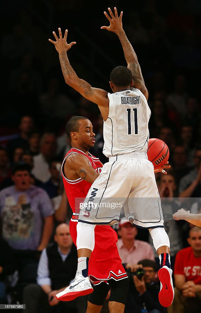 Lorenzo Brown #2 of the North Carolina State Wolfpack tries to pass the ball as Ryan Boatright #11 of the Connecticut Huskies defends during the Jimmy V Classic on December 4, 2012 at Madison Square Garden in New York City.