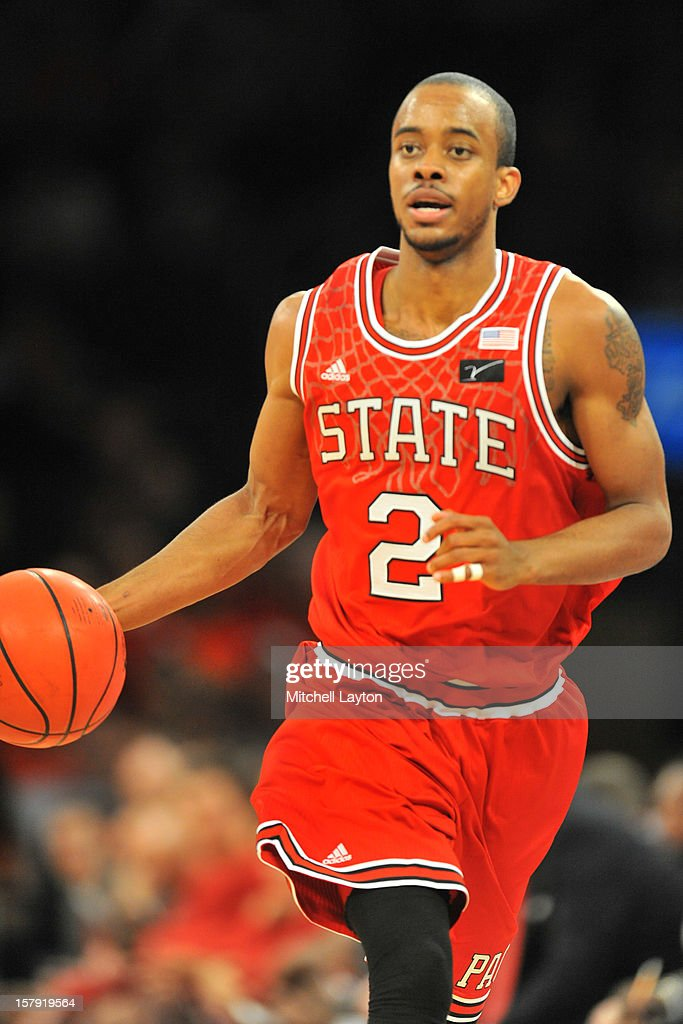 Lorenzo Brown #2 of the North Carolina Wolfpack dribbles up court during the Jimmy V Classic college basketball game against the Connecticut Huskies on December 4, 2012 at Madison Square Garden in New York, New York. The Wolfpack won 69-65.
