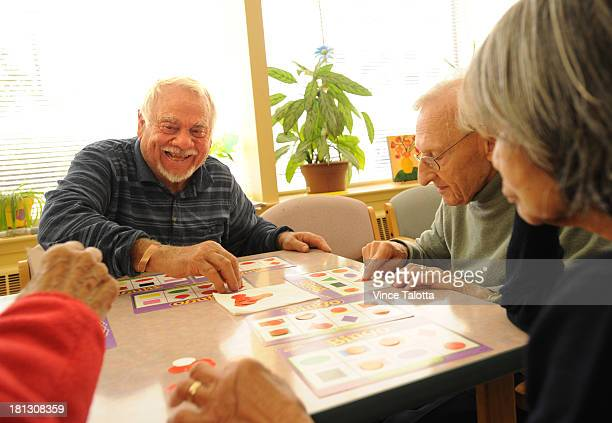 Lorenzo Brunato suffering from early stages of dementia has as friendly game of bingo with other people suffering from the same thing at Downsview...