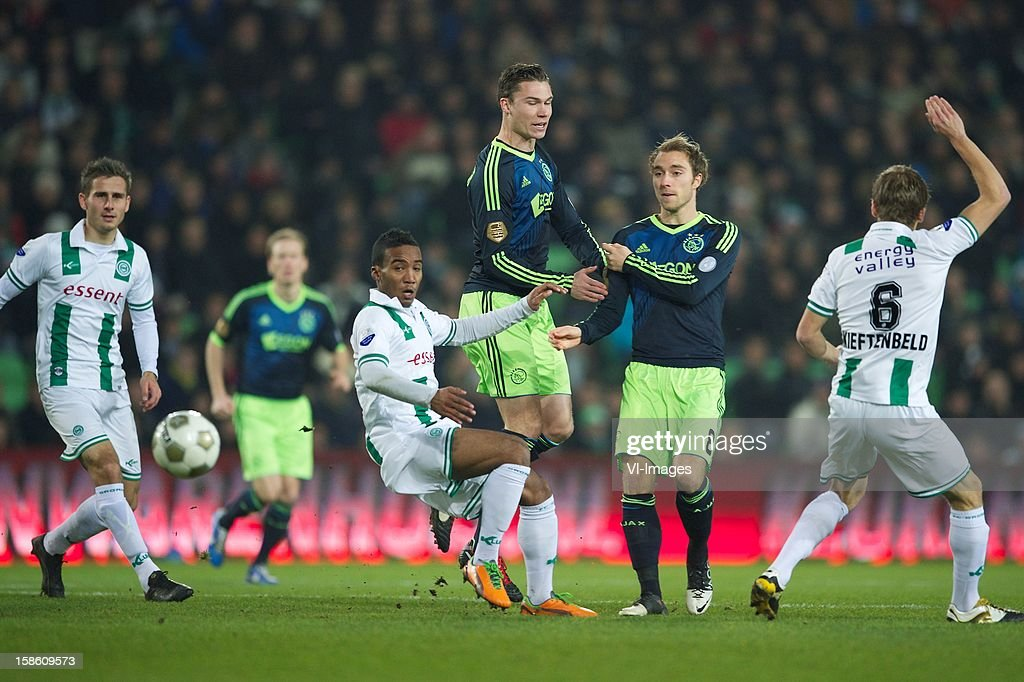 Lorenzo Burnet of FC Groningen, Derk Boerrigter of Ajax, Christian Eriksen of Ajax during the Dutch Cup match between FC Groningen and Ajax Amsterdam at the Euroborg on December 20, 2012 in Groningen, The Netherlands.